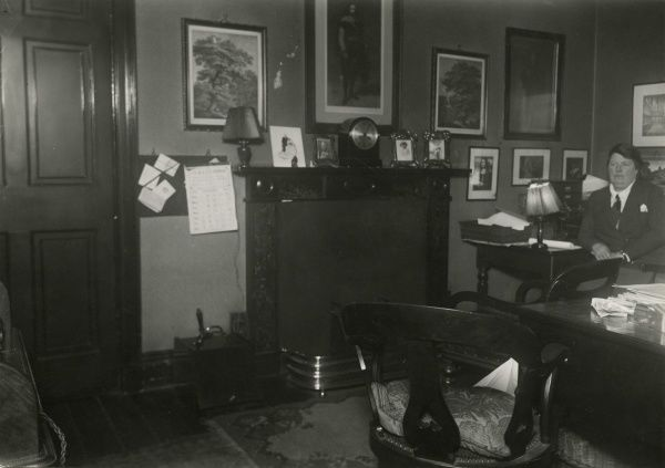 Photograph of Esson Maude recreating where she sat during sitting with the Scottish medium Helen Duncan at the sance venue in Edinburgh, January 1933. This is one of series of photographs of Harry Price's investigations into the mediumship of Helen Duncan