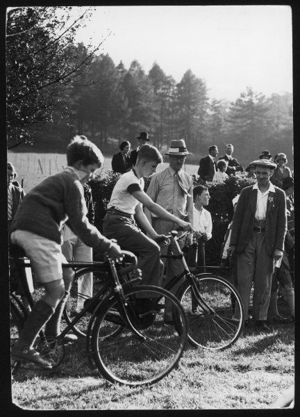 A cycling race at Hascombe Fair, Surrey, England