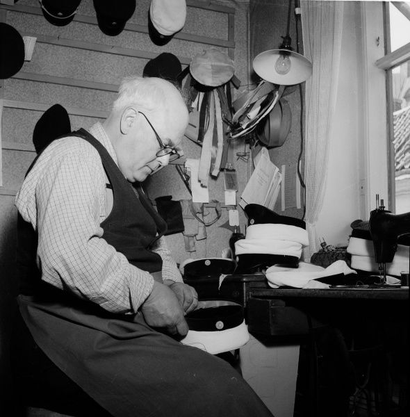 A hatter making a cap, used by Swedish students after reaching GCE A-level. Landskrona, Sweden 1949. Date: 1949