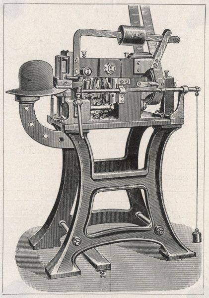 An interesting and intriguing hatmaking machine which is shown here in the process of flattening a hat brim