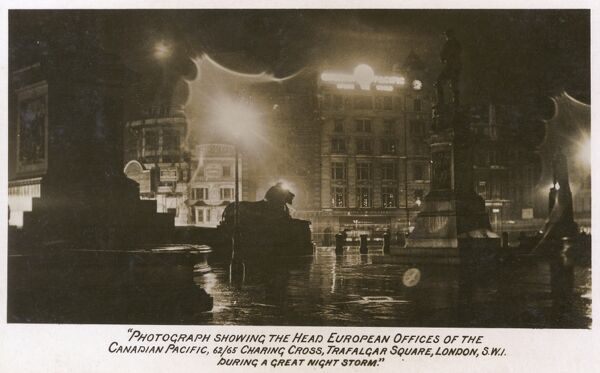 The Head European Offices of Canadian Pacific, 62-65 Charing Cross Road, Trafalgar Square, London - photographed during a 'great night storm'. Date: 1924