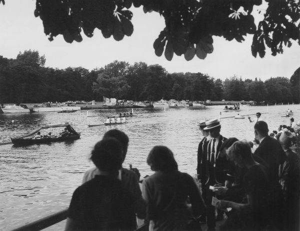Watching the Henley Regatta boat race from the banks of the River Thames, Surrey, England. Date: 1966