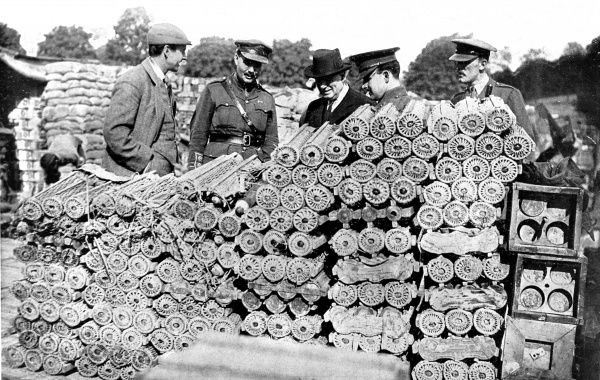 The British Prime Minister Herbert Henry Asquith (1852-1928) during a three day visit to the British front in September, 1916. The Prime Minister is pictured examining German ammunition captured by the British army