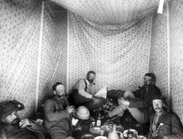 Herbert Kitchener (later Lord Kitchener, 1850-1916) and others inside their tent whilst on a mapping survey of Western Palestine (Israel, West Bank and Gaza today) for the Palestine Exploration Fund. Kitchener was an officer in the Royal Engineers at the time