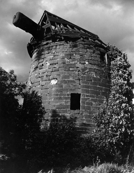 The remains of the old windmill at Heswall, Wirral, Cheshire, England. Date: 1960s
