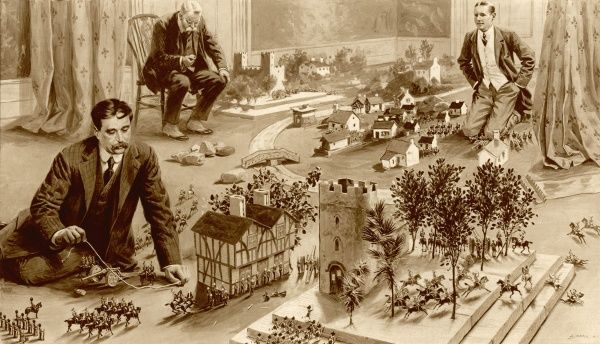H.G.Wells playing 'Little Wars'. His book of the same name, published in 1913, described a set of rules for playing with toy soldiers, and formed the basis of hobby wargaming which is still popular today. The picture shows Wells on the left