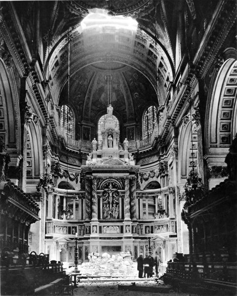 Photograph showing the High Altar of St. Paul's Cathedral, London, after a German bomb had exploded on the choir roof and destroyed a large section of roof, 1940