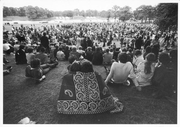 HIPPIES Hippies gather at a pop festival in Hyde Park, London. Two cuddle up underneath a blanket at the back