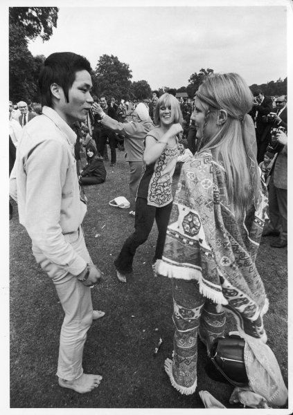 HIPPIES Hippies gather at a pop festival in Hyde Park, London. Everyone is barefoot and there is dancing in the background