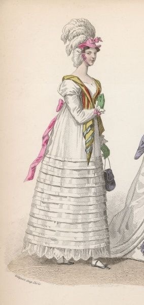 Long sleeved white dress with vandyked hem & 11 folds on the skirt & tied at the back with a pink ribbon. A later 19th century view of earlier dress
