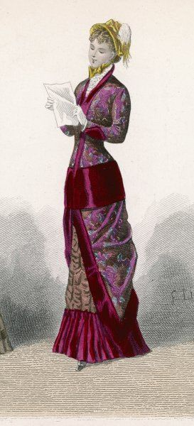 A costume of 3 fabrics: a lavish pattern bordered in red with a brown, ruched under- skirt. The over-skirt descends in points at the sides & is divided at the front