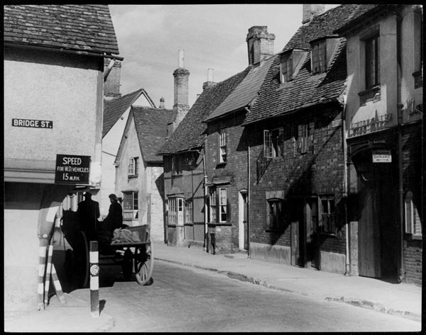 The corner of Bridge Street, Hitchin, Hertfordshire, where the speed limit for 'W.D.' (War Department) vehicles is 15 m.p.h. A horse and cart keeps strictly to this limit