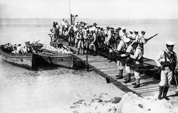 Landing party of HMAS Sydney arriving at Direction Island, in the Cocos (Keeling) Islands, Indian Ocean, the day after destroying the German raider Emden off North Keeling Island during the early part of the First World War.  10 November 1914