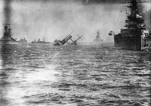 HMS Campania, British seaplane tender and aircraft carrier, sinking after hitting other ships (Royal Oak and Glorious) at anchor during a sudden storm in the Firth of Forth, Scotland. Date: 5 November 1918