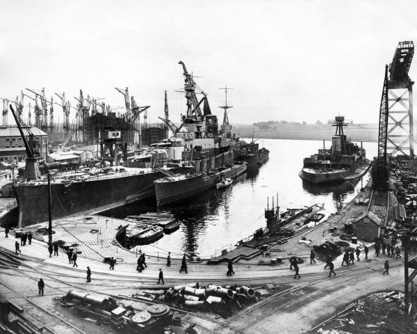 HMS Repulse, British Renown-class battlecruiser, launched 1916, served briefly during the First World War, served during the Second World War, sunk off Malaya 1941. Seen here (probably at the John Brown shipyard) with HMTBs (torpedo boats) Peregrine
