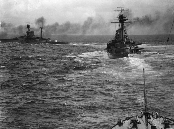 Two British ships at sea during the First World War. On the left in the distance is HMS Royal Sovereign, and on the right is HMS Resolution. Date: circa 1916