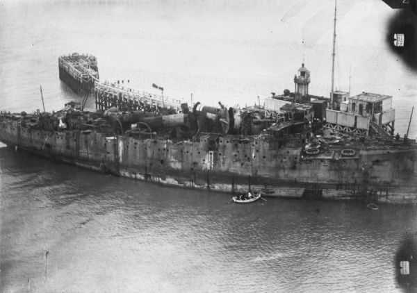 View of HMS Vindictive, an Arrogant-class protected cruiser, after the Zeebrugge Raid (23 April 1918), Belgium, when her upperworks were badly damaged by gunfire. Seen here at Ostend, where she had been sunk as a blockship during the Second Ostend Raid