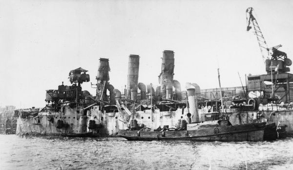 View of HMS Vindictive, an Arrogant-class protected cruiser, after the Zeebrugge Raid (23 April 1918), Belgium, when her upperworks were badly damaged by gunfire. She was later sunk as a blockship at Ostend during the Second Ostend Raid on 10 May 1918