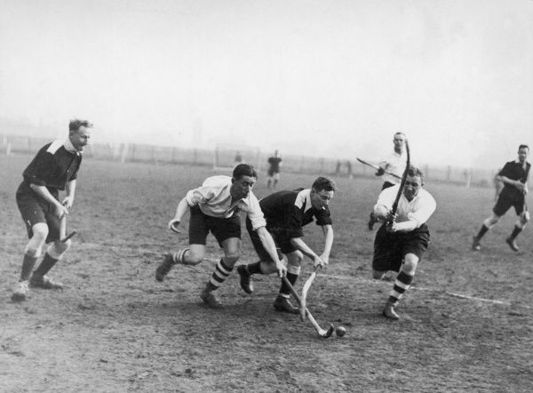 A men's hockey match for the service championship at Merton Abbey. The Army forwards attack the Navy goal. Date: 1930s