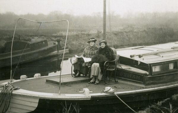A splendid set of two postcards depicting aspects of two ladies' holiday to the Norfolk Broads