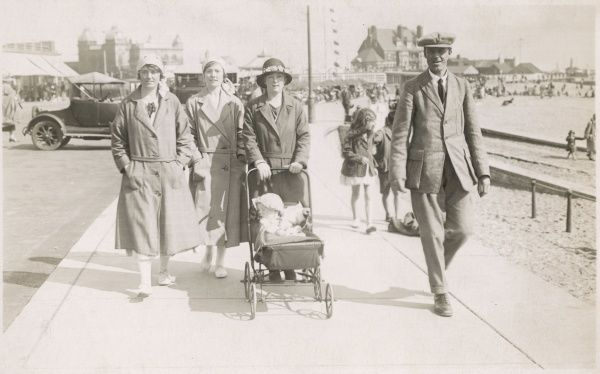 As this holidaymaking family stroll along the promenade at Gorleston-on-Sea in Norfolk, they are snapped by a hopeful photographer