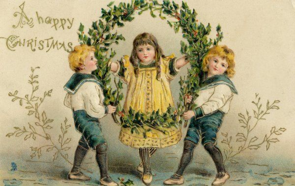 Three children with a large wreath of holly