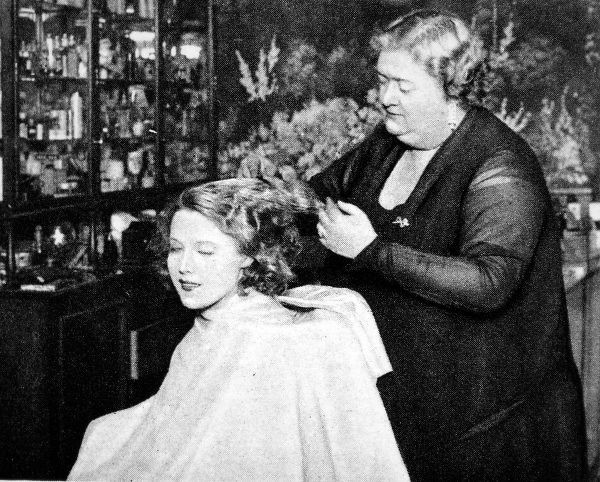 The Hollywood hairdressing salon of the British 'Hollywood'. Mme Franzi Jaschke attending to Miss Annie Ondra in the great film studios at Elstree