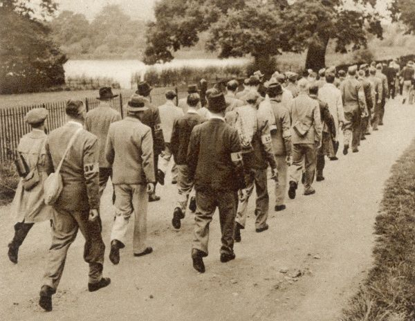 Members of the Home Guard on their way to a field in the grounds of Osterley Park, in the suburbs of west London, where lectures and demonstrations are given by experts during an intensive training course for local defense volunteers