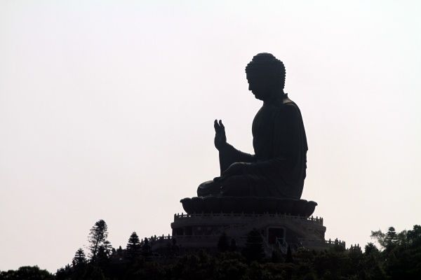 Silhouette of the Tian Tan Buddha statue on Lantau Island in Hong Kong, China