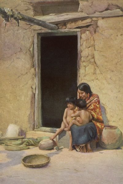 A mother and two children of the Hopi people, outside their home in Mishongnovi, Arizona
