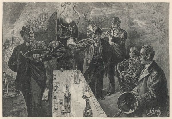 A group of gentlemen and a small boy congregate in a wine cellar to practice playing the horn whilst enjoying a drink or two (non-alcoholic for the small boy of course)