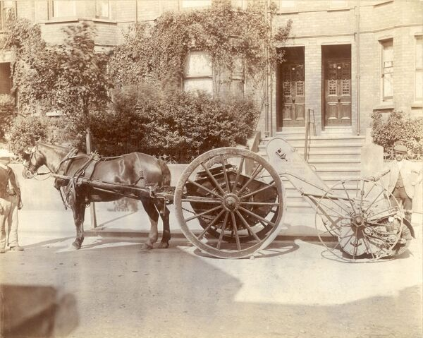 A marvellous photograph of a horse-drawn road sweeper, made by J. T Whittomb of Tavistock