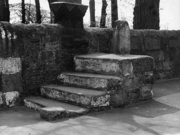 The old stone mounting steps at Adel Church, Leeds, Yorkshire, England, reminding us of the days when people went to church on horseback. Date: 1950s