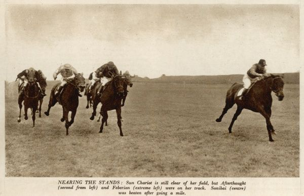 Horse racing at Newmarket during World War II. Nearing the stands, Sun Chariot is still clear of her field but Afterthought (second from left) and Feberion (extreme left) were on her track. Sonibai (centre) was beaten after going a mile