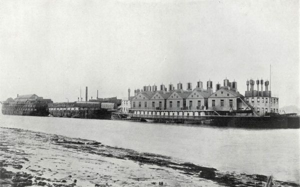 The Metropolitan Asylums Board hospital ships Atlas (left), Endymion (centre) and Castalia (right) on the River Thames at Long Reach near Dartford, Kent