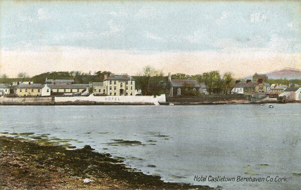 View over the water toward the Hotel at Castletown Berehaven, County Cork, Ireland Date: circa 1905