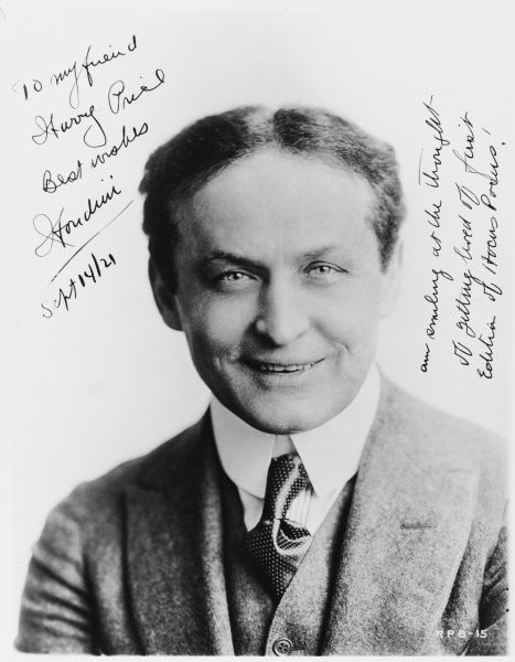 "A signed photograph of Harry Houdini in 1921 dedicated to ""my friend Harry Price&quot"
