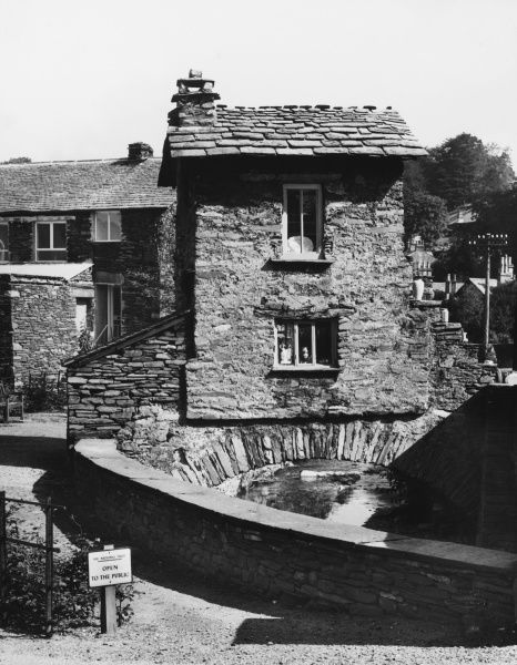 This house was built on a bridge over a river in 1680. It is situated in Ambleside, Westmorland