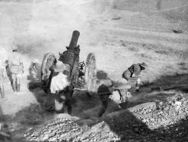 A 6 inch (30 cwt) Howitzer in action in the desert during the First World War. Date: 1914-1918