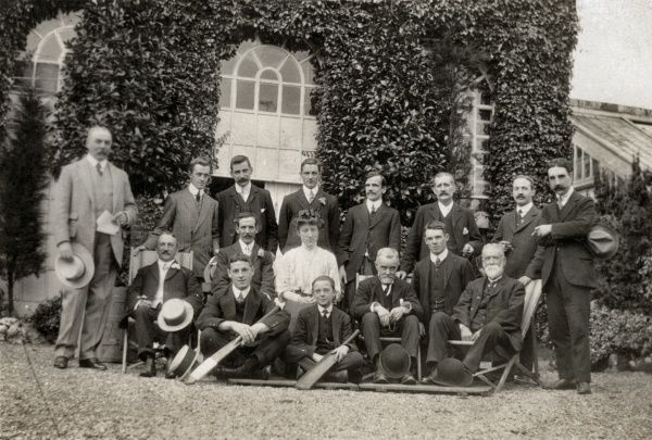 A picture of what is presumably the cricket team of the Kingston-upon-Hull Incorporation workhouse in Hull, Yorkshire. The workhouse master and matron are seated at the centre of the picture which shows the workhouse building in the background