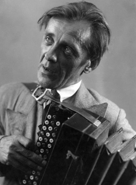 A Hungarian peasant playing an accordion. Date: 1930s