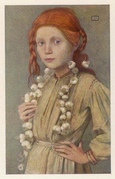 A young Hungarian girl has strings of garlic, round her neck