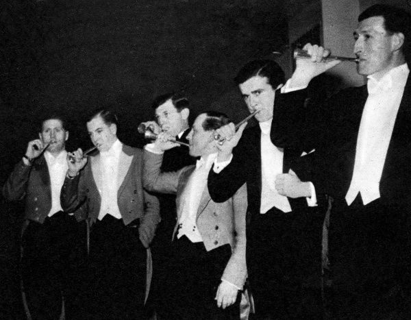 Competitors rehearsing in the hunting-horn contest at the Horse and Hound Ball at Grosvenor House in London. Date: 1951