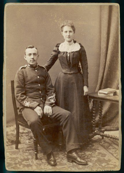 A soldier and his wife pose for their photograph