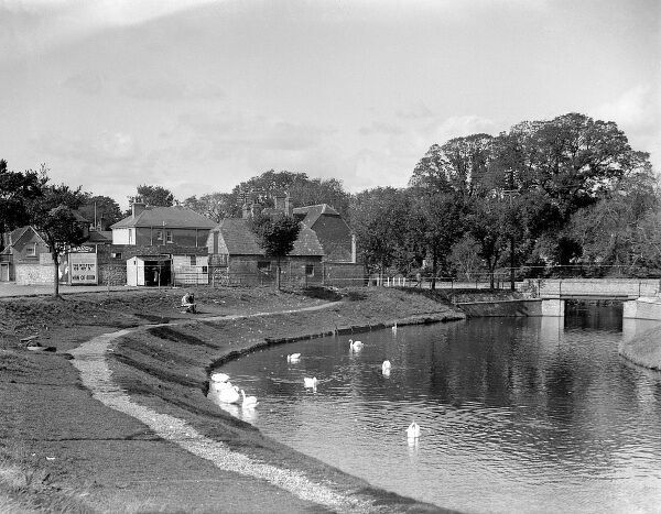 The Royal Military Canal at Hythe, Kent, England. Note the poster advertising 'The Mystery of Mr. X' Date: 1934