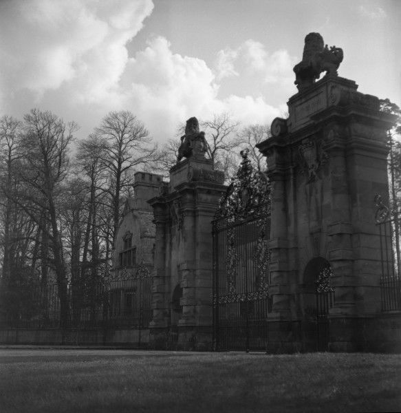 The impressive stone entrance gateway to a large stately home or country manor house. Photograph by Norman Synge Waller Budd