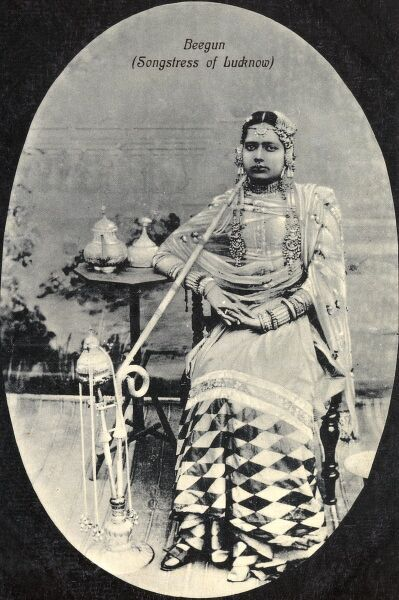 India - Beegun Songstress from Lucknow with an extremely exotic water pipe (nargile) Date: circa 1910s