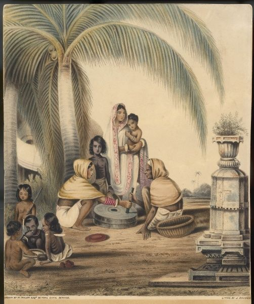Indian women grinding corn in a hand-mill