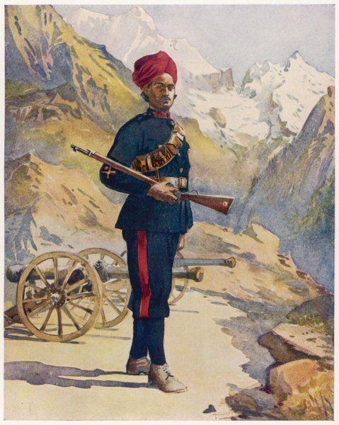 A Gunner of the Mountain Battery, holding his rifle. Mountains and two cannons are in the background