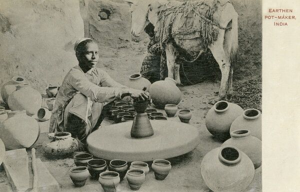 Indian Potter surrounded by his wares